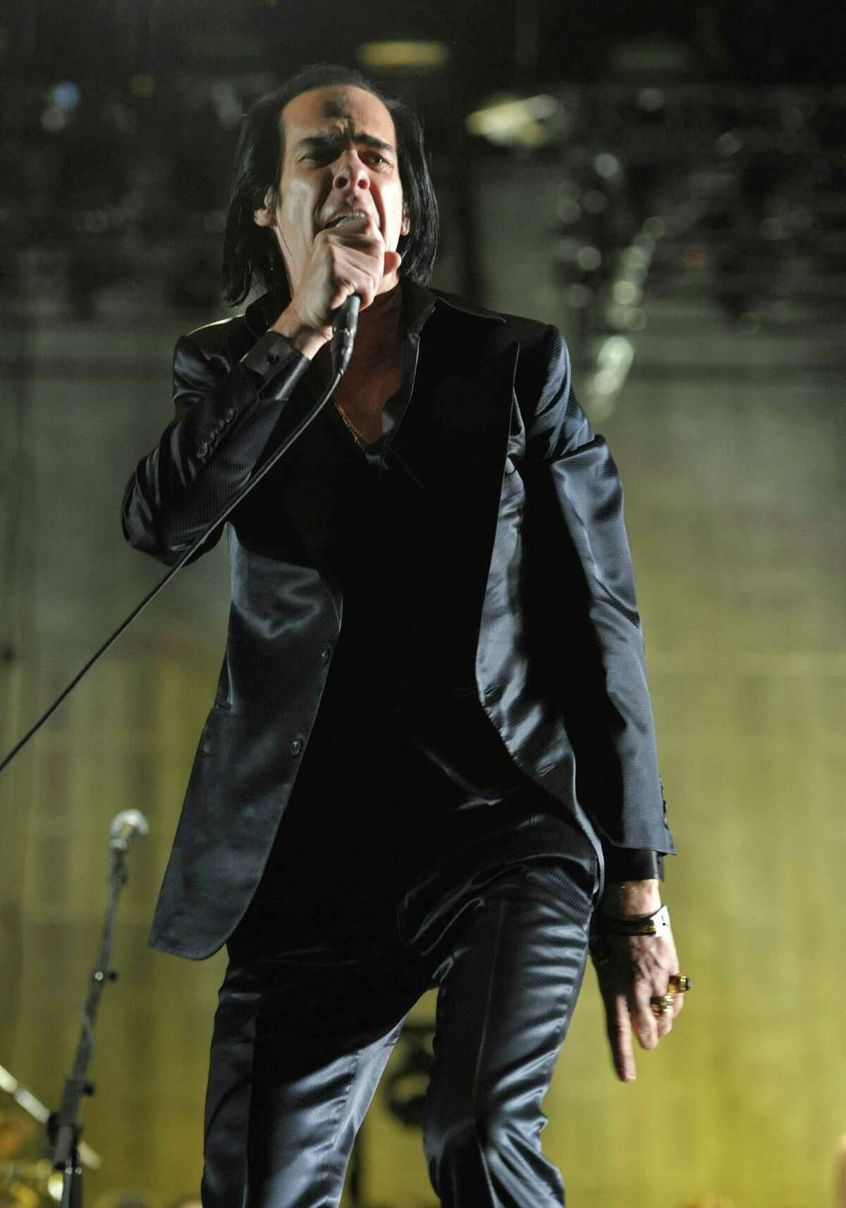 Nick Cave performs with the Bad Seeds during the second weekend of the 2013 Coachella Valley Music and Arts Festival at the Empire Polo Club on Sunday, April 21, 2013 in Indio, Calif. (Photo by John Shearer/Invision/AP)