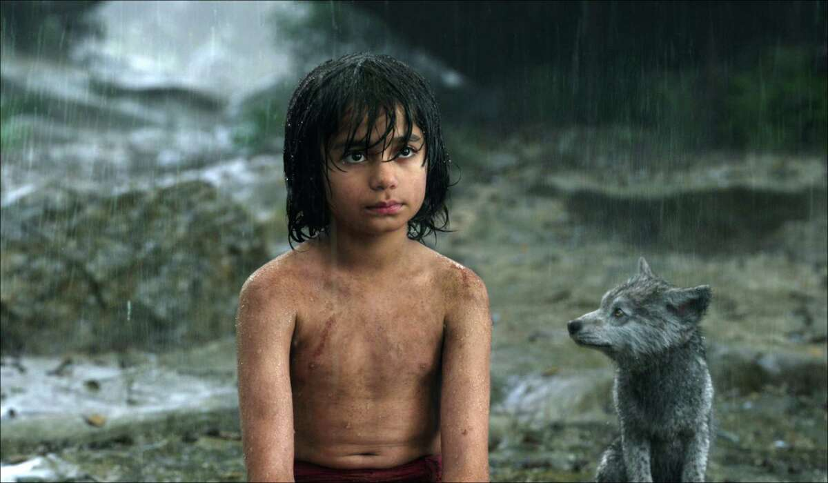 In this image released by Disney, Mowgli, portrayed by Neel Sethi, left, and Gray, voiced by Brighton Rose, appear in a scene from,