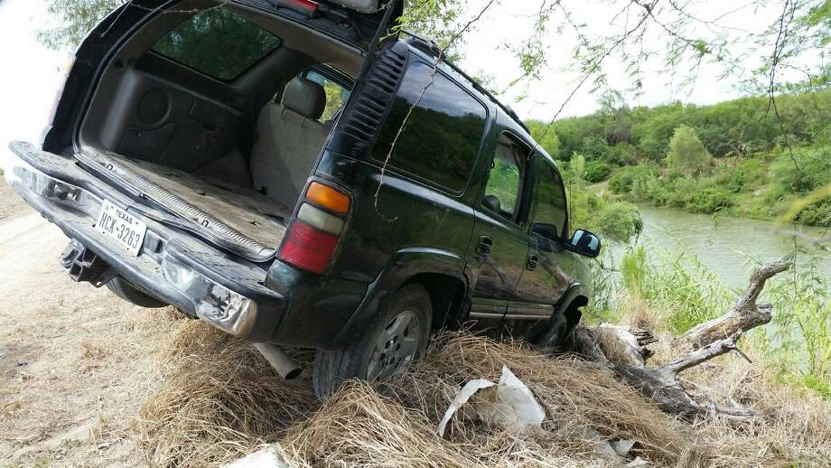 The driver and passengers of this SUV allegedly tried swimming back to Mexico after crashing the drug laden vehicle into the Rio Grande, US Customs Border Protection agents say. Photo: Courtesy Customs And Border Protection