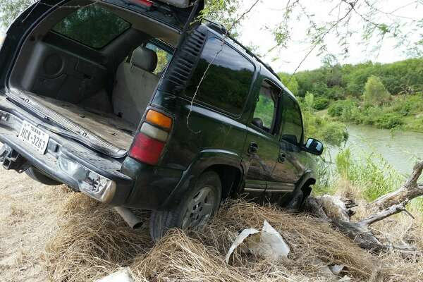 The driver and passengers of this SUV allegedly tried swimming back to Mexico after crashing the drug laden vehicle into the Rio Grande, US Customs Border Protection agents say.