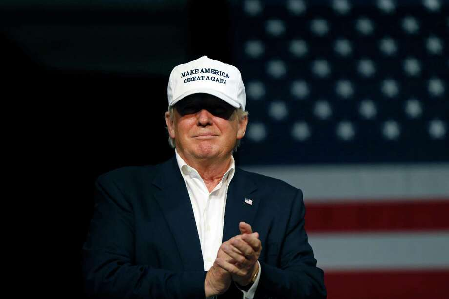 Republican presidential candidate Donald Trump arrives onstage to speak at a rally in Dimondale, Mich.. Friday, Aug. 19, 2016. (AP Photo/Gerald Herbert) Photo: Gerald Herbert, STF / Copyright 2016 The Associated Press. All rights reserved. This material may not be published, broadcast, rewritten or redistribu