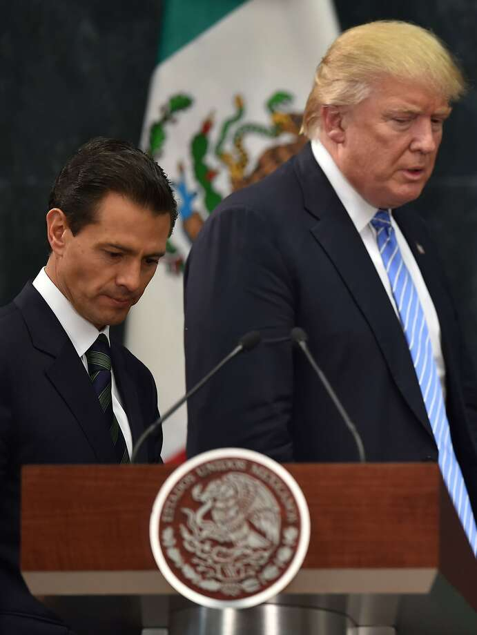 US presidential candidate Donald Trump (R) and Mexican President Enrique Pena Nieto prepare to deliver a joint press conference in Mexico City on August 31, 2016. Donald Trump was expected in Mexico Wednesday to meet its president, in a move aimed at showing that despite the Republican White House hopeful's hardline opposition to illegal immigration he is no close-minded xenophobe. Trump stunned the political establishment when he announced late Tuesday that he was making the surprise trip south of the border to meet with President Enrique Pena Nieto, a sharp Trump critic.  / AFP PHOTO / YURI CORTEZYURI CORTEZ/AFP/Getty Images Photo: YURI CORTEZ, AFP/Getty Images