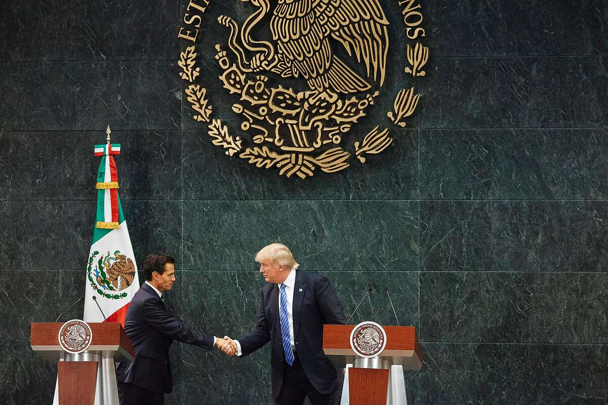 Mexican President Enrique Pena Nieto and Donald Trump, the Republican presidential nominee, shake hands during a joint news conference, after the two met at the Los Pinos residence in Mexico City, Aug. 31, 2016. Trump said he focused on shared economic interests and security interests in their meeting. He also said he did discuss his intention to build a wall on the U.S.-Mexico border, but that the two did not discuss who would pay for it. (Rodrigo Cruz/The New York Times)