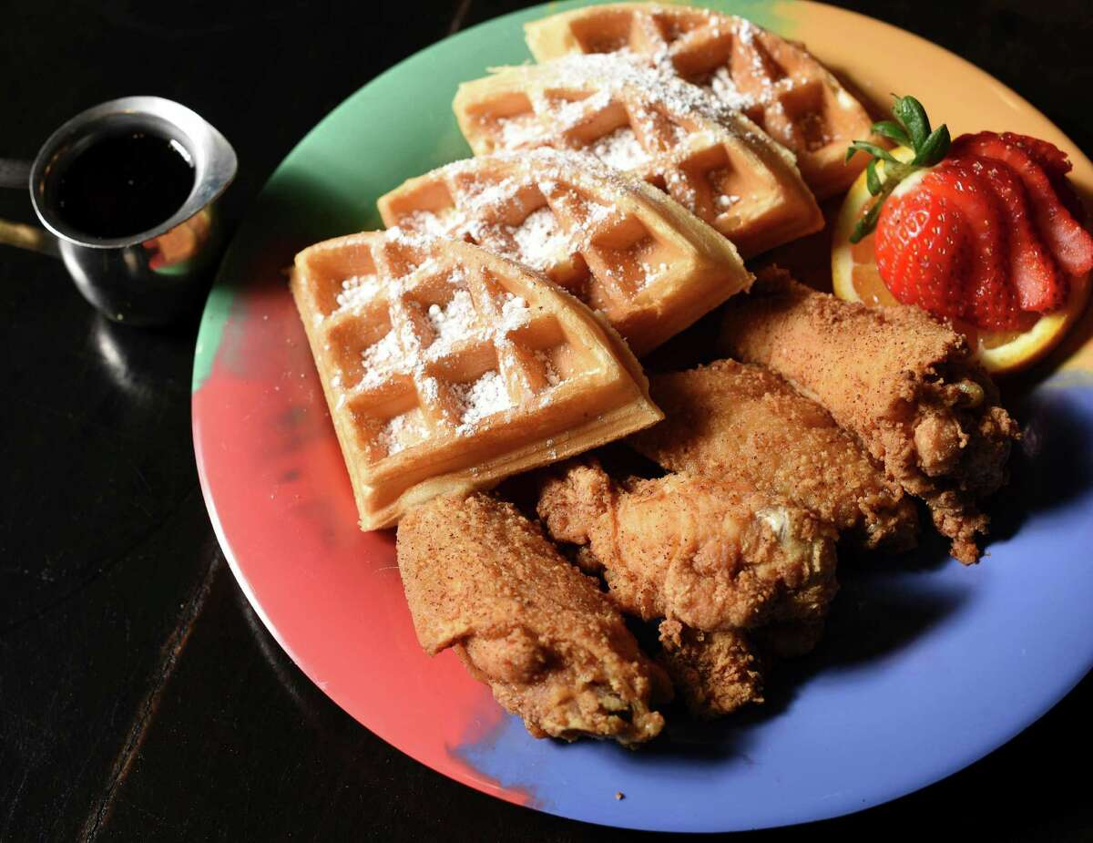 The classic soul food combination of chicken and waffles at Tony G's features chicken wings.