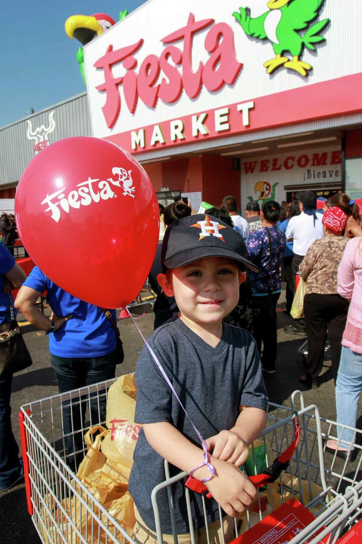 Three-year-old Mikey Gonzales at the grand re-opening of the Fiesta on Wayside Drive. Fiesta has invested in the store, redesigning and updating its appearance and layout, the first of several planned upgrades at the chain's stores. Mikey was with his mother, Letty Gonzales. (For the Chronicle/Gary Fountain, August 31, 2016)