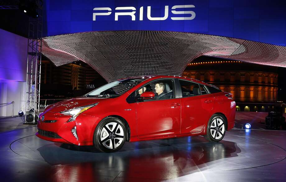 FILE - In this Sept. 8, 2015 file photo, the latest version of the Prius is displayed by Toyota at an event in Las Vegas. Toyota Motor Corp. released details for its fourth-generation Prius on Tuesday, Oct. 13, promising that improvements in the battery, engine, wind resistance and weight mean better mileage for the world's top-selling hybrid car. It gets up to 40 kilometers a liter under Japanese tests, which translates to more than 93 miles per gallon, a 20 percent improvement from the 2015 model. In the U.S., it gets 55 mpg in combined city and highway driving, about 10 percent better. (AP Photo/John Locher, File) Photo: John Locher, Associated Press