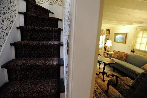 The narrow staircase is set directly behind the living room inside the former home of Stamford founder John Scofield, built in 1860, on Eden Rd. in Springdale section of Stamford, Conn. on Monday, August 29, 2016.