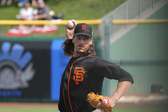 Giants' starting pitcher Jeff Samardzija, 29 throws in the first inning as the San Francisco Giants play the Los Angeles Angels at Scottsdale Stadium on Wed. March 2,  2016, in Scottsdale, Arizona.