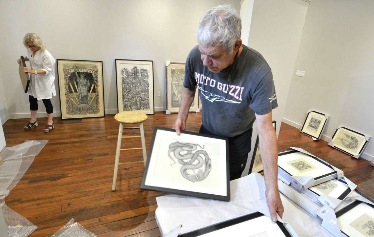 Artist James Grashow works with Executive Director Laura Einstein placing his prints for hanging. About 50 of his works will be on exhibit September 10 through December 10 at the Center for Contemporary Printmaking, James 'Grashow Prince of Prints' Conn.