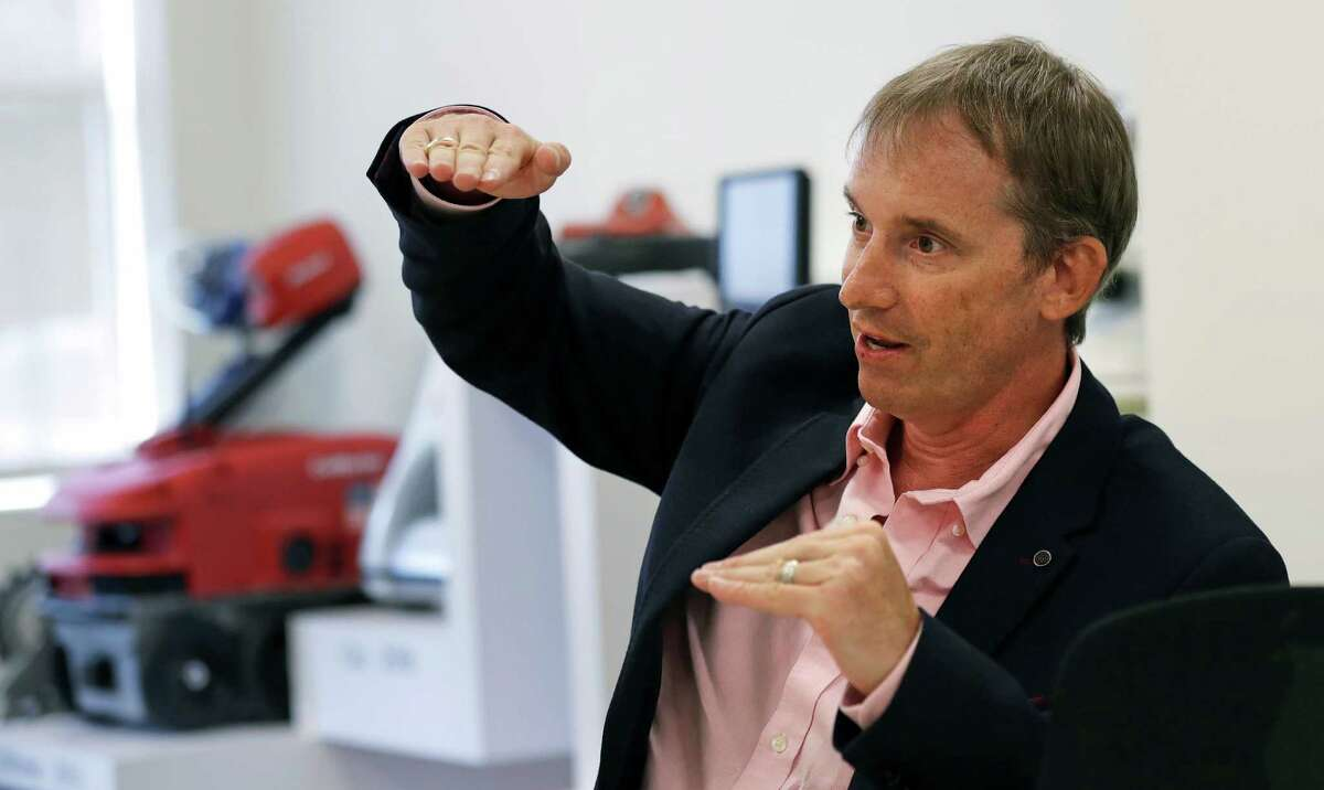 In this Thursday, Aug. 25, 2016, photo, iRobot co-founder and CEO Colin Angle speaks during an interview at the company's headquarters in Bedford, Mass. Angle talked about his company's transition away from military projects to household robots. (AP Photo/Charles Krupa) ORG XMIT: MACK202