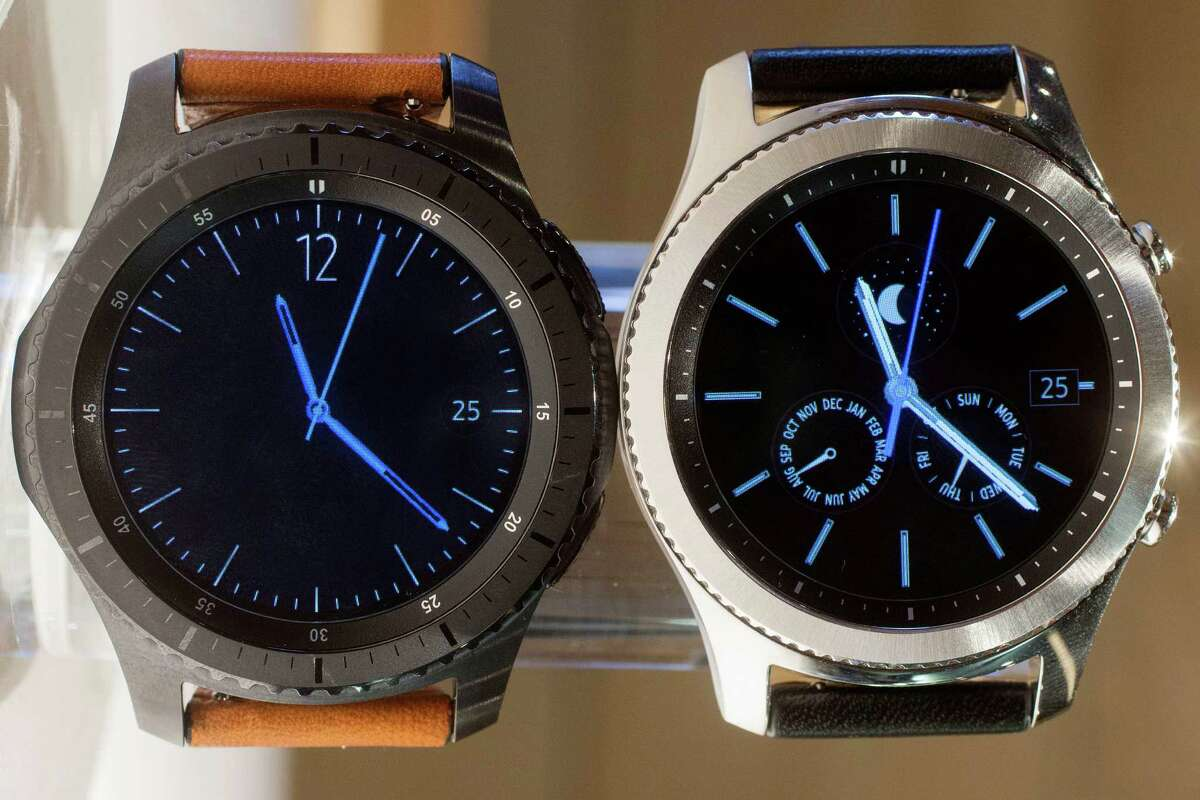 In this Aug. 25, 2016, photo, the Samsung S3 frontier, left, and classic version are displayed in New York. Samsung's next smartwatch will come with GPS capabilities and the ability to seek help by triple-tapping a side button. GPS will help Samsung stand out with the Gear S3, as the feature so far isn't common in smartwatches. But the watch still faces a dearth in apps compared with Android and Apple. (AP Photo/Mark Lennihan) ORG XMIT: NYML301