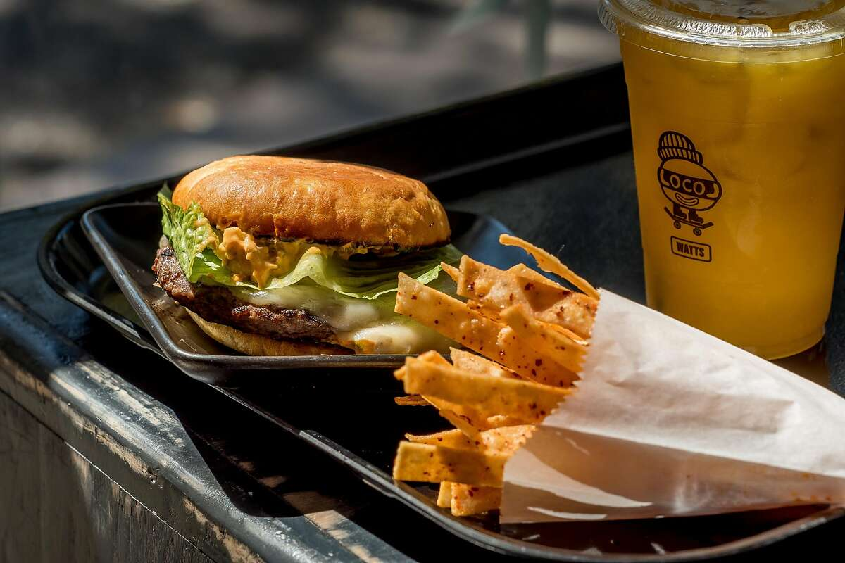 The Hamburger with the spicy Corn Chips and an Apricot-Orange Aqua Fresca at Locol in Oakland, Calif. is seen on August 31st, 2016.