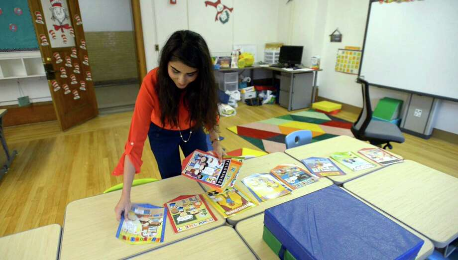 Amina Toor, a first year, first grade teacher at New School in Stamford, sets up her classroom on Wednesday, Aug. 31, 2016. Toor grew up in Stamford and graduated from the Stamford Public School system. Photo: Matthew Brown / Hearst Connecticut Media / Stamford Advocate