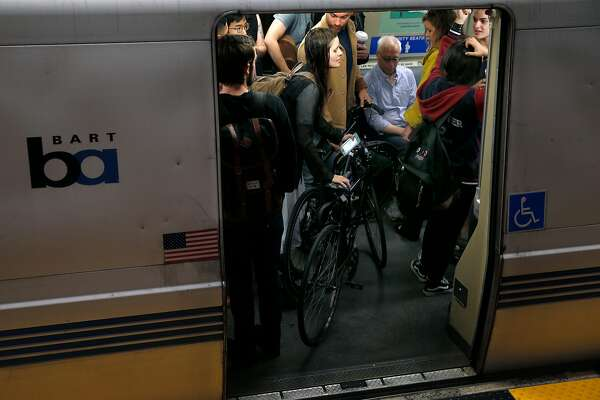 Passengers stand inside a train headed to San Francisco at the 19th Street BART station in Oakland, Calif. on Aug. 30, 2016.