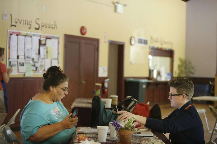 Dianna Urbina (left), who has been homeless for three years, works at the Recovery Cafe with manager Lisa Williams, who was helping Urbina write up her story for publication. Photo: Lea Suzuki, The Chronicle