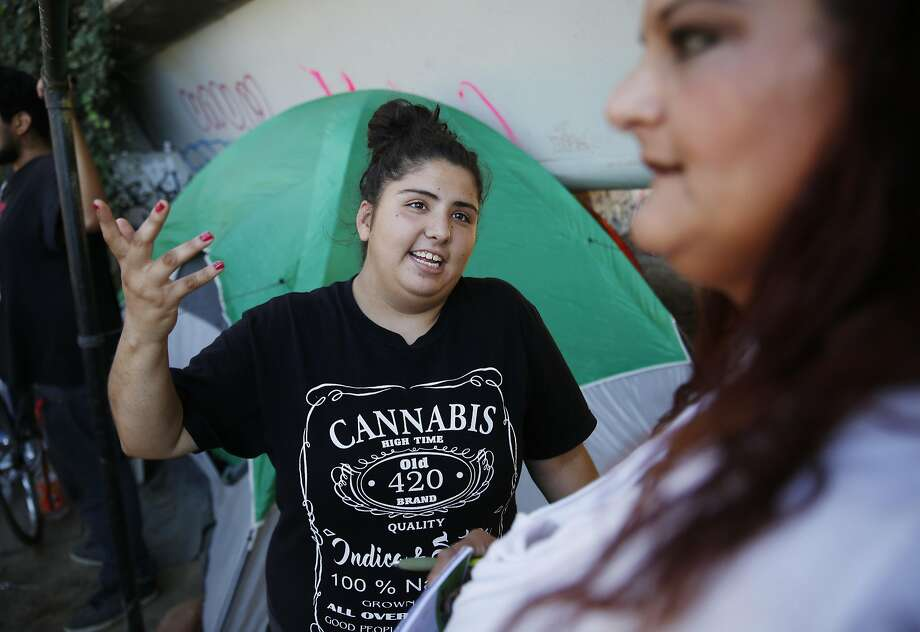 Alyssa Garcia, 19, talks with her mother, Maricela Salgado, who has been homeless on and off for almost a year, as they stand next to their tent under Highway 280. Photo: Lea Suzuki, The Chronicle