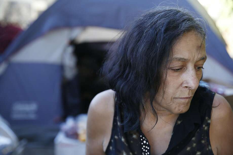Colette stands outside the tent of her and partner Pete Martinez (not shown)  on Tuesday, August 30,  2016 in San Jose, California. Photo: Lea Suzuki, The Chronicle