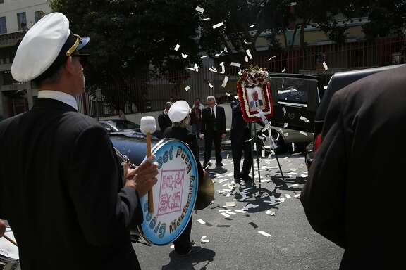 Members of the Green Street Mortuary Band play as the family and mortuary perform the final rituals of the funeral procession through China Town after a service at Green Street Mortuary August 23, 2016 in San Francisco, Calif.