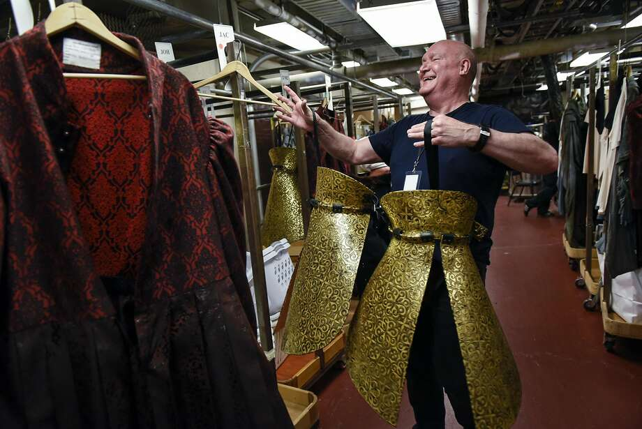 "Dresser Scott Stewart, a union member, arranges costumes for the San Francisco Opera world premiere of ""Dream of the Red Chamber."" Photo: Michael Short, Special To The Chronicle"