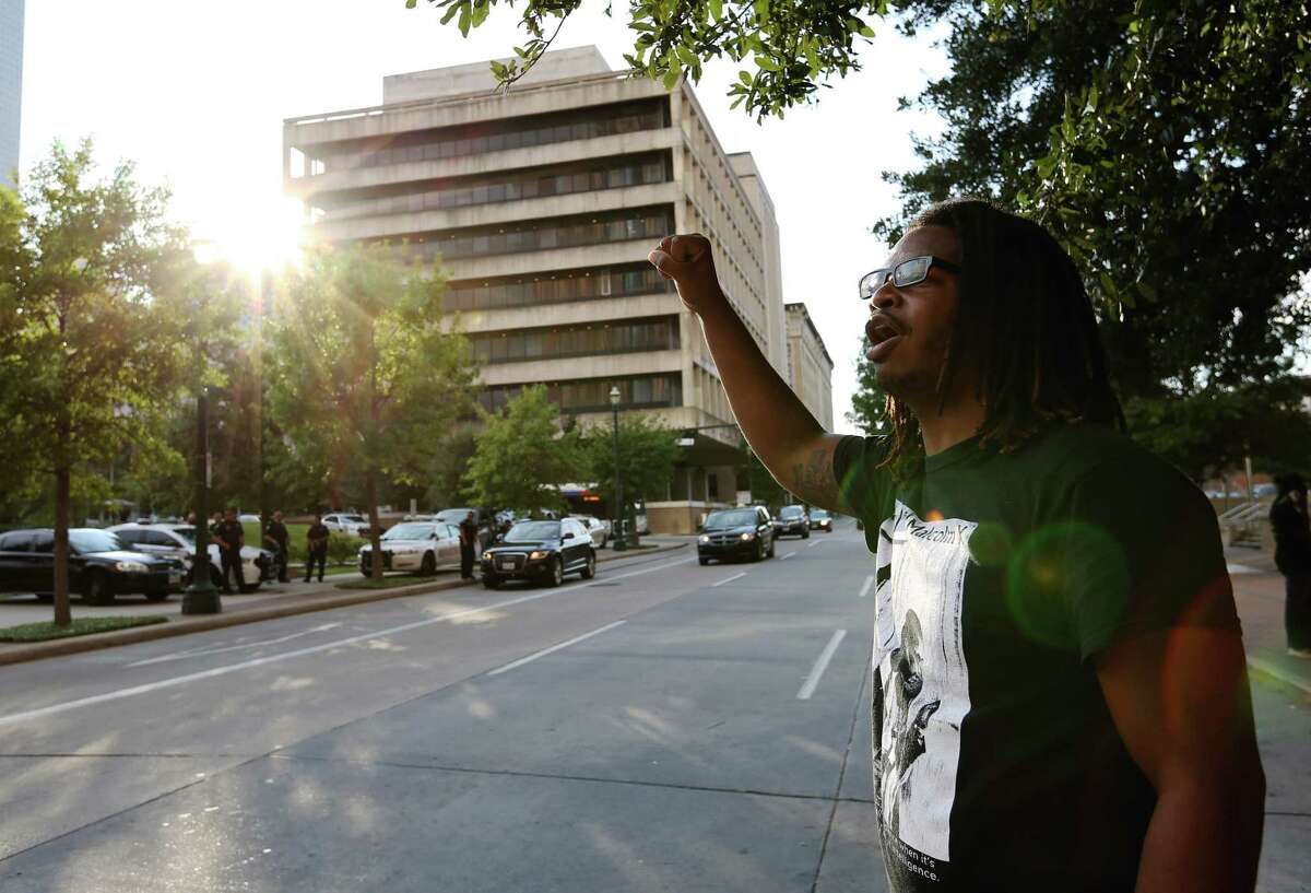 Gregory Chatman shouts across the street to the police at the protest.