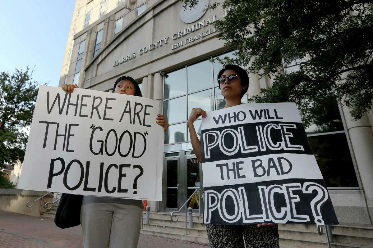 Sisters Karina Rivera, left, and Mayra Rivera protest outside Harris County 180th Criminal Court on Wednesday after a grand-jury no-billed a Precinct 5 deputy who shot and killed Ashtian Barnes in April.