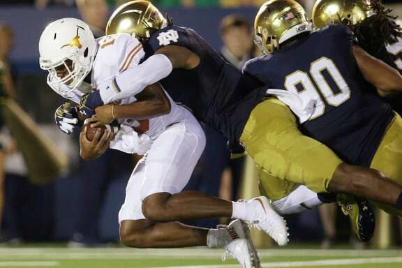 Jerrod Heard, being sacked against Notre Dame last season, has moved to wide receiver but hasn't changed his stance that it's time for the Longhorns to produce.