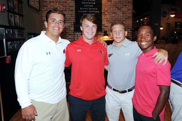Greenwich football players from left, Ben Kraninger, Paul Williams, Mike Ceci and Tyler Farris take part in the Ruden Report's FCIAC football media event at the Colony Grill in Norwalk on Wednesday.