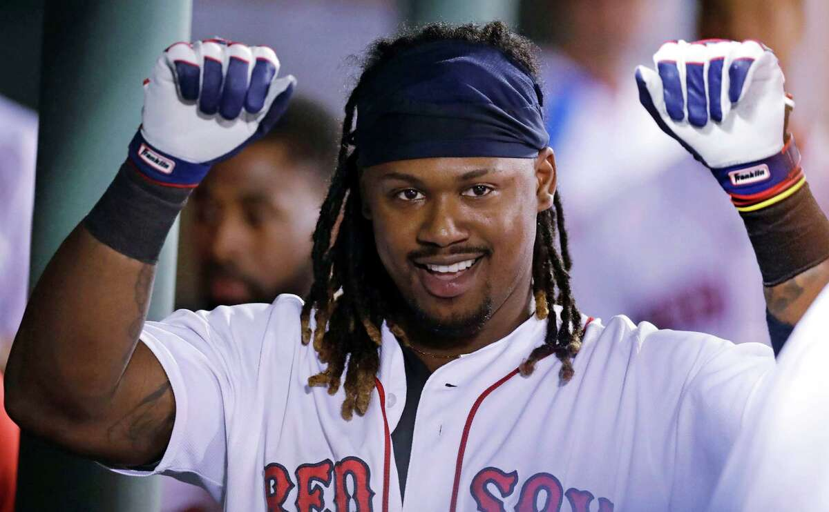 Boston Red Sox's Hanley Ramirez raises his arms as he celebrates in the dugout after his solo home run during the fifth inning of a baseball game against the Tampa Bay Rays at Fenway Park, Tuesday, Aug. 30, 2016, in Boston. (AP Photo/Charles Krupa) ORG XMIT: MACK112
