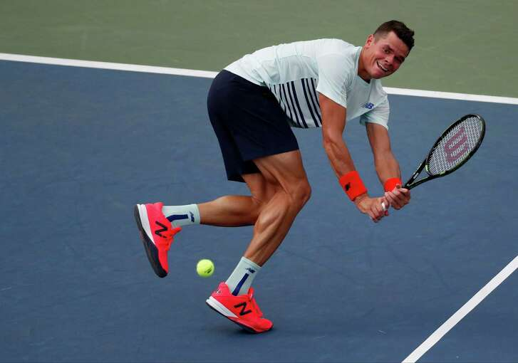 Milos Raonic, of Canada, returns a shot to Ryan Harrison, of the United States, during the second round of the U.S. Open tennis tournament, Wednesday, Aug. 31, 2016, in New York. (AP Photo/Alex Brandon)