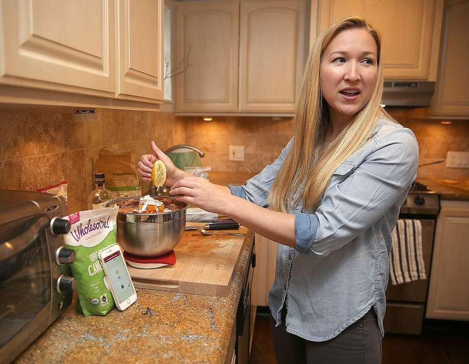 Culinary adviser Jessica Entzel shows how she makes bourbon peach pie using the Drop scale and app. Photo: Liz Hafalia, The Chronicle