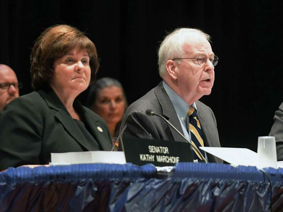 Senator Kathy Marchione, left, listens as Senator Kemp Hannon, right, addresses those gathered for the start of the New York State Senate Joint Public Hearing on Tuesday, Aug. 30, 2016, at Hoosick Falls High School in Hoosick Falls, N.Y. (Paul Buckowski / Times Union)