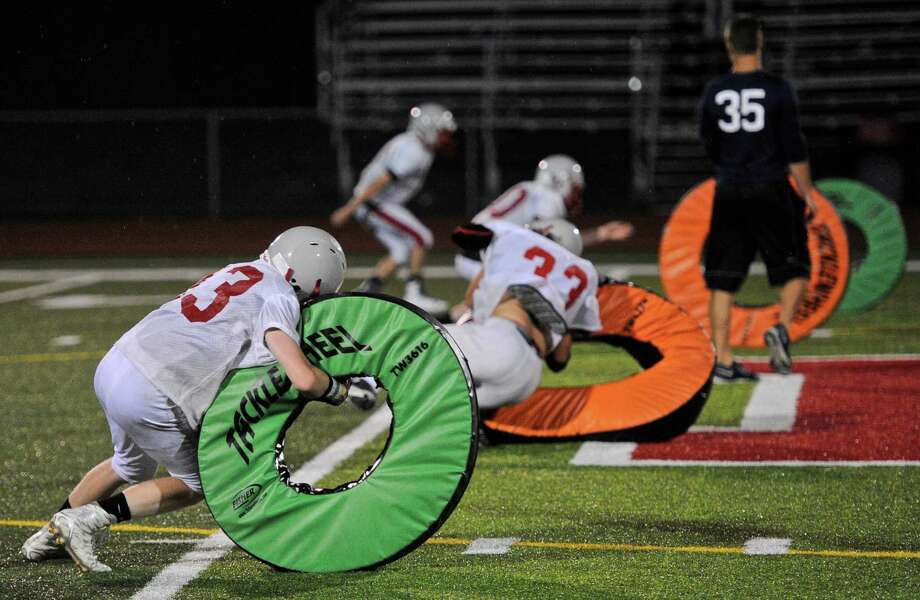 Pomperaug High School football practice, Wednesday night, August 31, 2016, in Southbury, Conn. Photo: H John Voorhees III / Hearst Connecticut Media / The News-Times