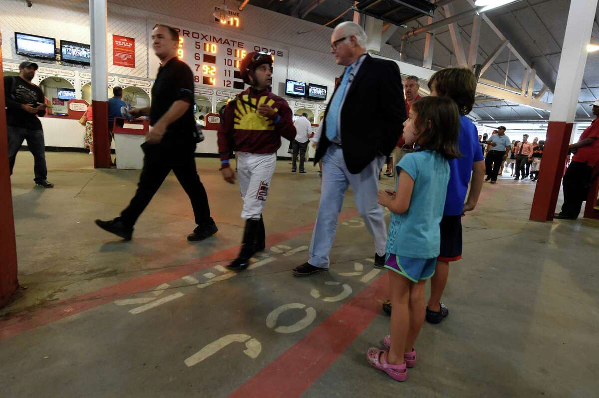 Kids wait patiently for a glimpse of jockey Joe Bravo after the 9th race at the Saratoga Race Course Wednesday August 31, 2016 at in Saratoga Springs, N.Y. (Skip Dickstein/Times Union)