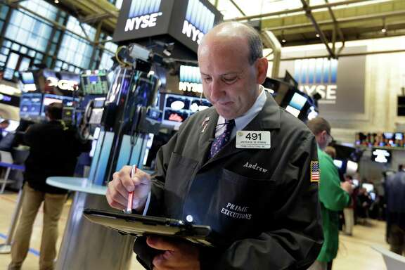 Trader Andrew Silverman works on the floor of the New York Stock Exchange, Wednesday, Aug. 31, 2016. Stocks are opening slightly lower on Wall Street as a thin batch of earnings gave investors little to get excited about. (AP Photo/Richard Drew)