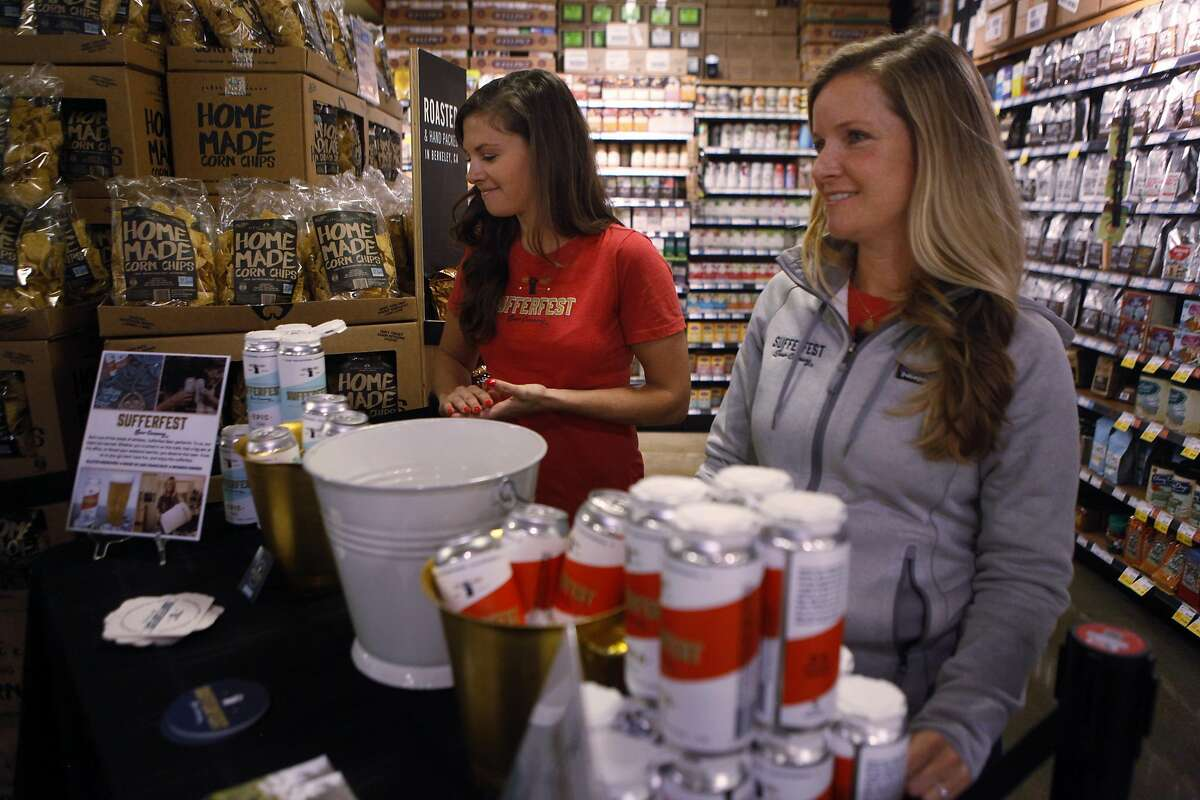 Danni Zuralo, left, and Caitlin Landesberg, right, of Sufferfest Beer Company hand out samples of Taper IPA and Epic Pilsner to Whole Food Potrero Hill customers in San Francisco, Calif., on Wednesday, August 31, 2016.