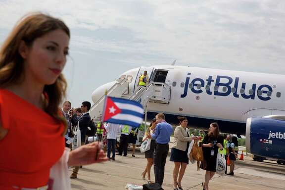 Passengers of JetBlue flight 387 arrives at the airport in Santa Clara, Cuba, Wednesday, Aug. 31, 2016. JetBlue 387, the first commercial flight between the U.S. and Cuba in more than a half century, landed in the central city of Santa Clara on Wednesday morning, re-establishing regular air service severed at the height of the Cold War. (AP Photo/Ramon Espinosa)
