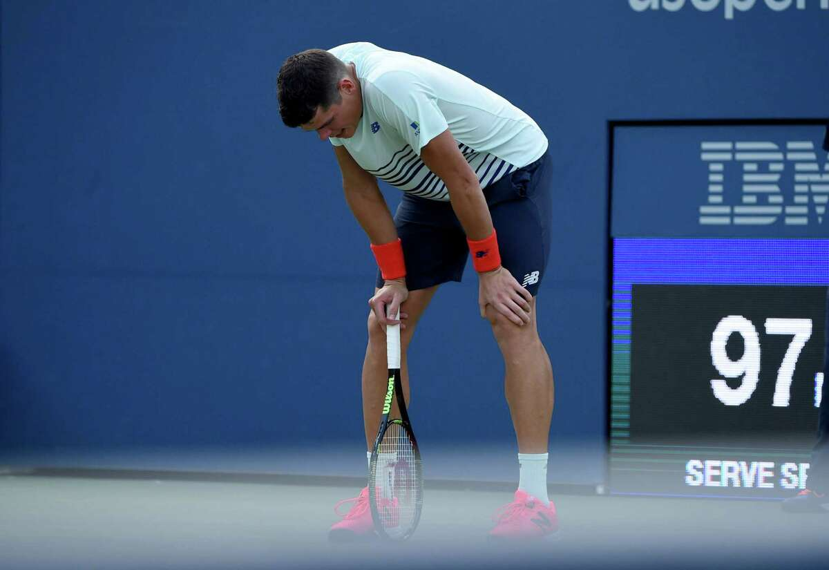 Milos Raonic of Canada pauses on court during his 2016 US Open 2016 Men's Singles match against Ryan Harrison of the US at the USTA Billie Jean King National Tennis Center in New York on August 31, 2016. / AFP PHOTO / TIMOTHY A. CLARYTIMOTHY A. CLARY/AFP/Getty Images ORG XMIT: 2016 U.S.