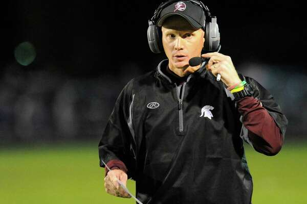 Burnt Hills-Ballston Lake head coach Matt Shell instructs his players against Schalmont during the first half of their Section II football game on Friday, Sept. 26, 2014, in Rotterdam, N.Y., (Hans Pennink / Special to the Times Union) ORG XMIT: HP103