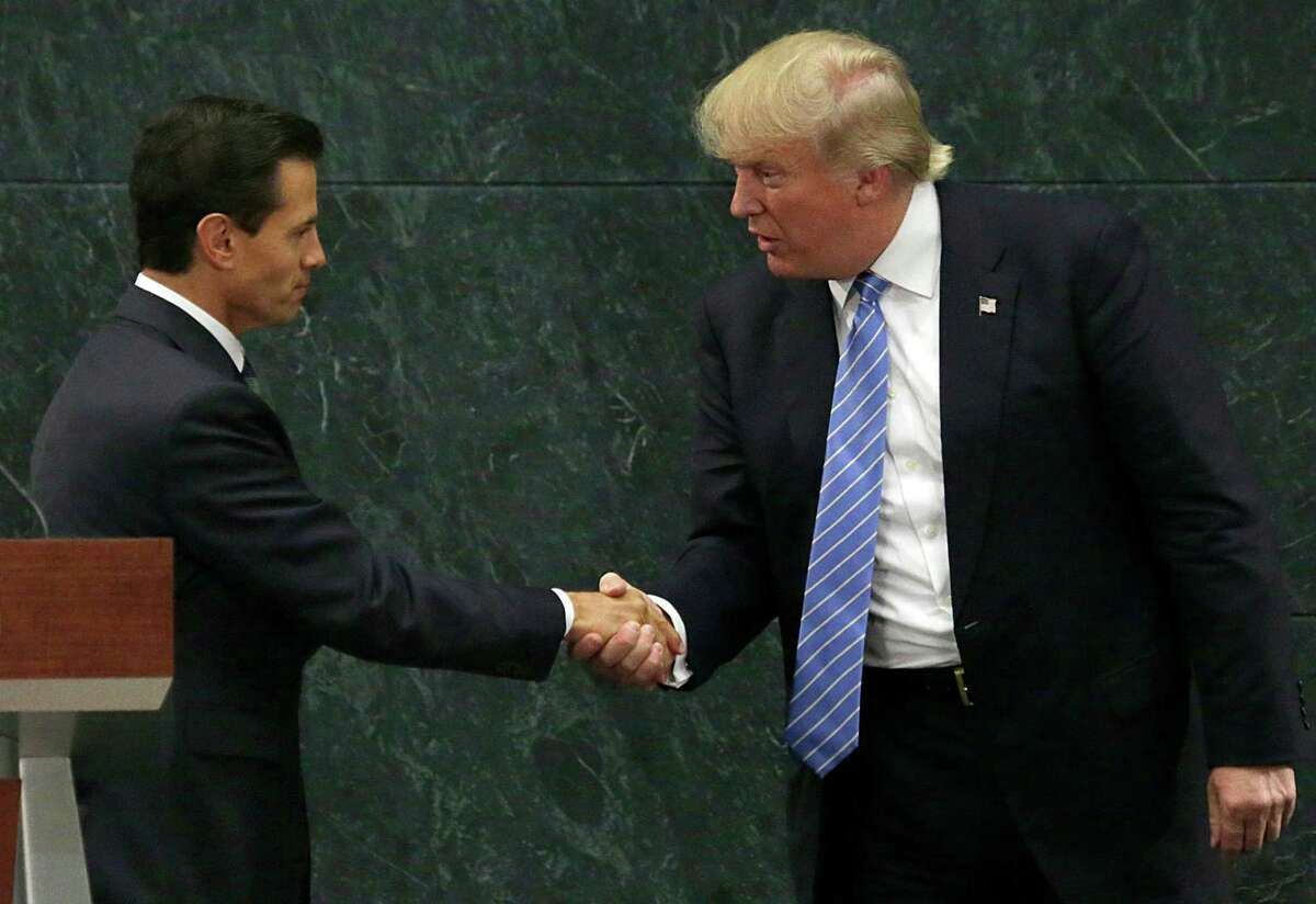 Mexico President Enrique Pena Nieto and Republican presidential nominee Donald Trump shake hands after a joint statement at Los Pinos, the presidential official residence, in Mexico City, Wednesday, Aug. 31, 2016. Trump is calling his surprise visit to Mexico City Wednesday a 'great honor.' The Republican presidential nominee said after meeting with Pena Nieto that the pair had a substantive, direct and constructive exchange of ideas.v(AP Photo/Marco Ugarte) ORG XMIT: MXMU108
