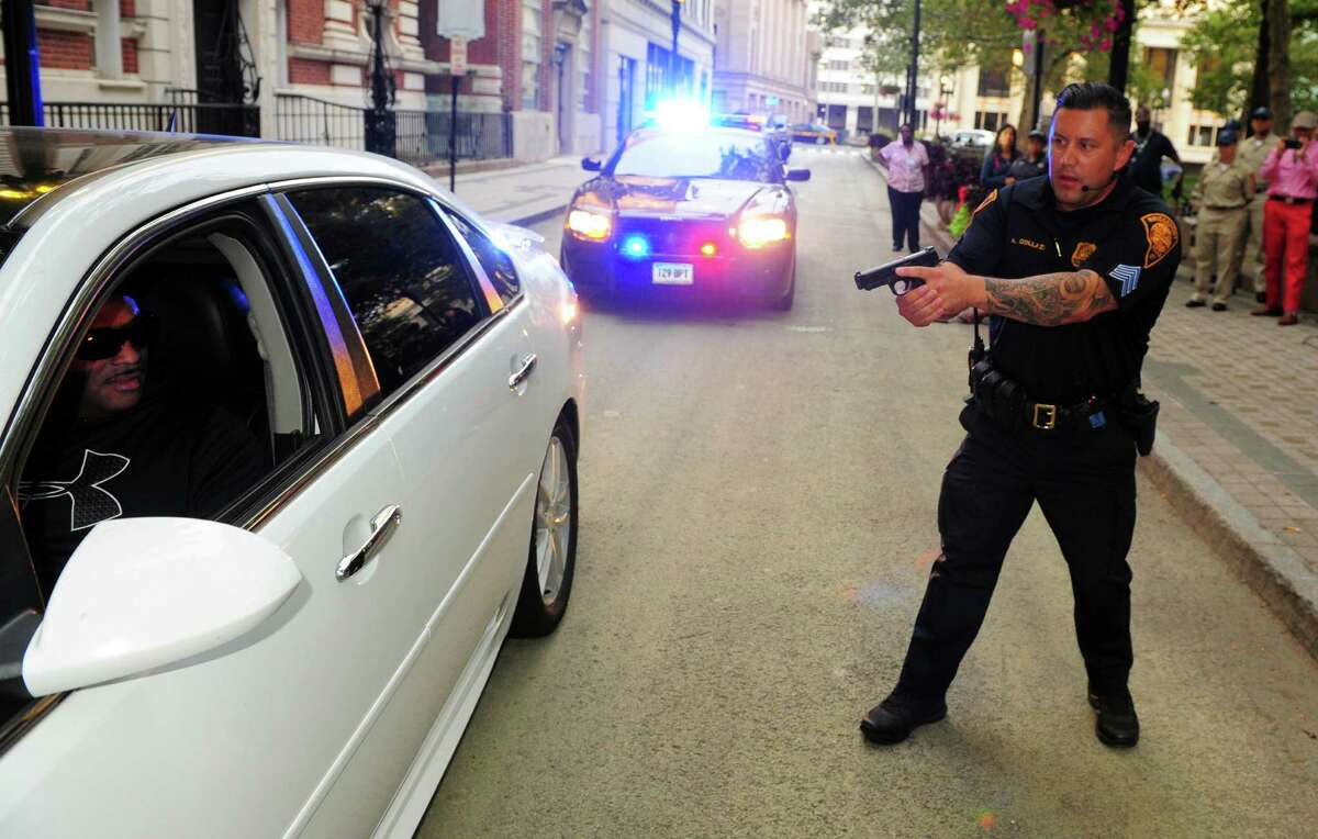Bridgeport Police Department, in conjunction with agencies such as Project Longevity and others, held a police stop demonstration session for members of the public on Bank Street in Bridgeport, Conn., on Thursday Mar. 31, 2016.