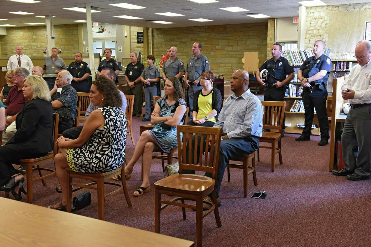 People attend a press conference to help AAA spread the word about keeping children safe while walking, biking and busing to school at Colonie Central High School on Wednesday, Aug. 31, 2016 in Colonie, N.Y. (Lori Van Buren / Times Union)