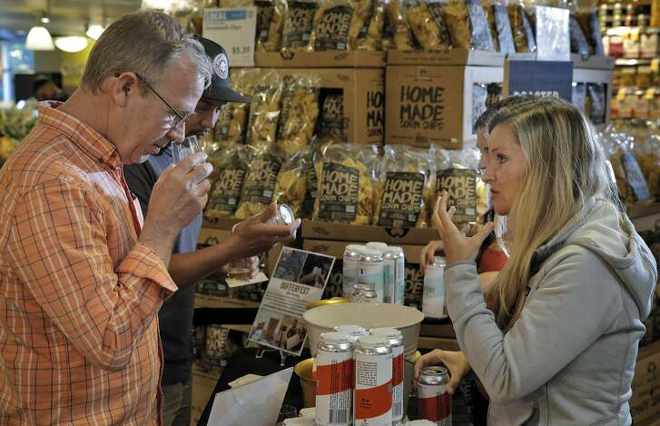 Jonathan Stone tries a sample Sufferfest Beer from Caitlin Landesberg, founder and CEO of Company, and Danni Zuralow, who were offering free samples of their Epic Pilsner and Taper IPA beers at Whole Foods in Potrero Hill in San Francisco, Calif., on Wednesday, August 31, 2016.