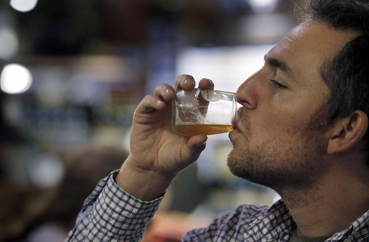 Eric Gladstone tries a beer given to him by Caitlin Landesberg, founder and CEO of Sufferfest Beer Company, and Danni Zuralow, as they offered free samples of their Epic Pilsner and Taper IPA beers at Whole Foods in Potrero Hill in San Francisco, Calif., on Wednesday, August 31, 2016.
