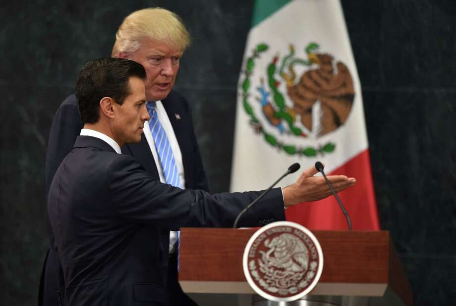 US presidential candidate Donald Trump (R) and Mexican President Enrique Pena Nieto prepare to deliver a joint press conference in Mexico City on August 31, 2016. Donald Trump was expected in Mexico Wednesday to meet its president, in a move aimed at showing that despite the Republican White House hopeful's hardline opposition to illegal immigration he is no close-minded xenophobe. Trump stunned the political establishment when he announced late Tuesday that he was making the surprise trip south of the border to meet with President Enrique Pena Nieto, a sharp Trump critic.  / AFP PHOTO / YURI CORTEZYURI CORTEZ/AFP/Getty Images Photo: YURI CORTEZ, Staff / AFP or licensors