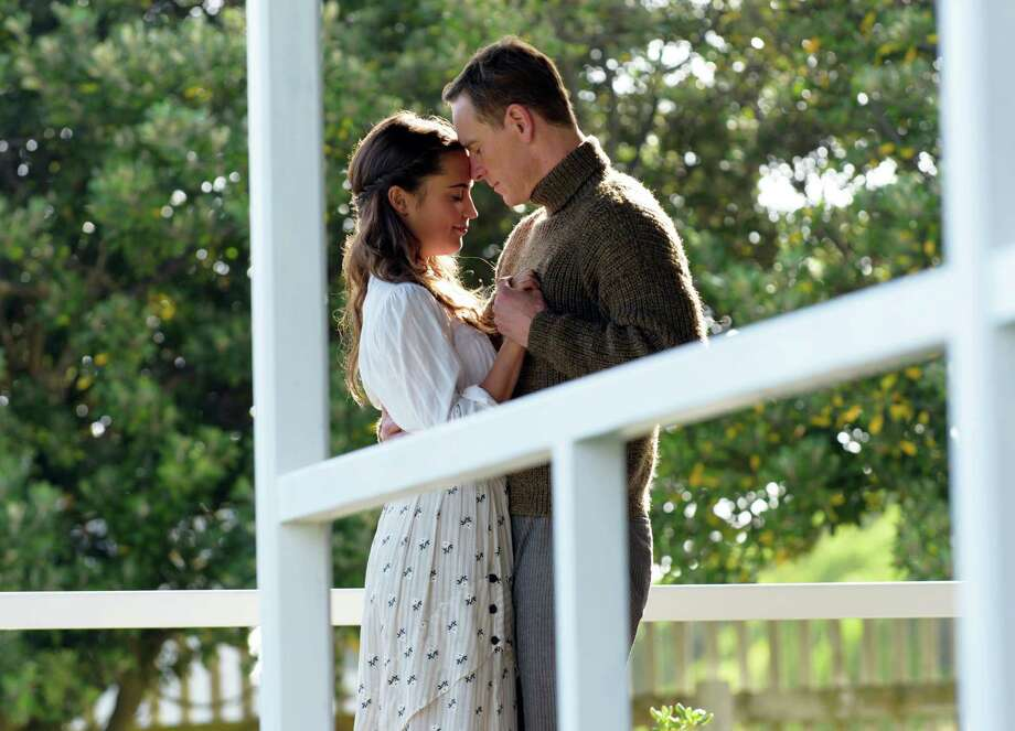 """This image released by Dreamworks II shows Alicia Vikander, left, and Michael Fassbender in a scene from, """"The Light Between Oceans."""" (Davi Russo/Dreamworks II via AP) Photo: Davi Russo, HONS / Associated Press / ©DreamWorks II Distribution Co., LLC. All Rights Reserved."""