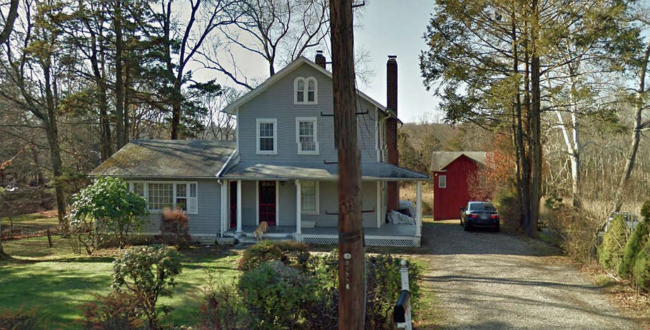 A barn, built in 1900, behind 265 Main St. in Westport was heavily damaged by fire on Thursday. Sept. 1, 2016. The lower part of the barn had a multi-bay garage and the second floor had a studio. Photo: Google Street View Image