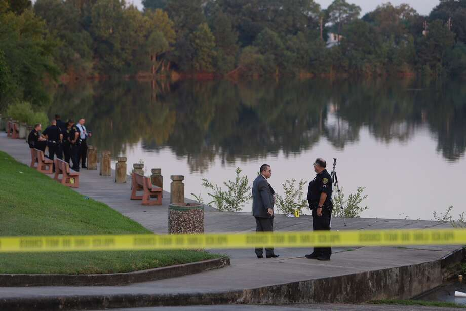 Police are shown at a scene where a body was in a lake along Windmill Lakes Blvd. Thursday, Sept. 1, 2016 in Houston.  ( Melissa Phillip / Houston Chronicle )