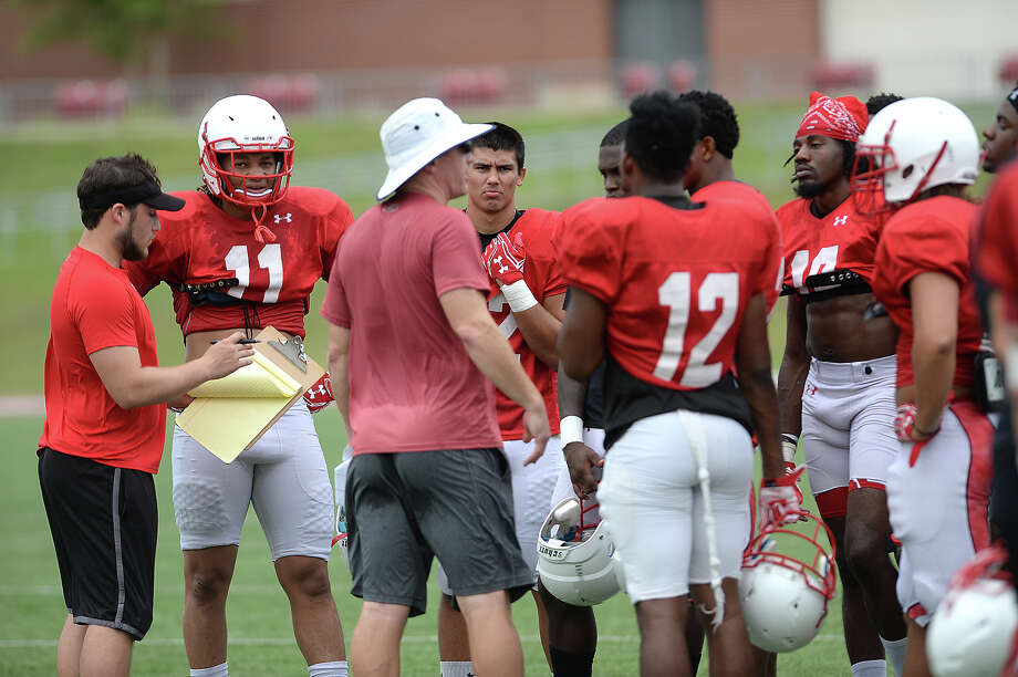 Lamar's defense get coaching advice on a break as the offense and defense grapple on field during their first fall season scrimmage Saturday. Photo taken Saturday, August 13, 2016 Kim Brent/The Enterprise Photo: Kim Brent / Beaumont Enterprise