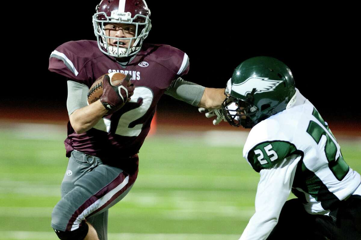 Burnt Hills' Michael Leveroni, left, stiff arms Green Tech's Damair Skervin during their football game on Friday, Oct. 2, 2015, at Burnt Hill High in Burnt Hills, N.Y. (Cindy Schultz / Times Union)