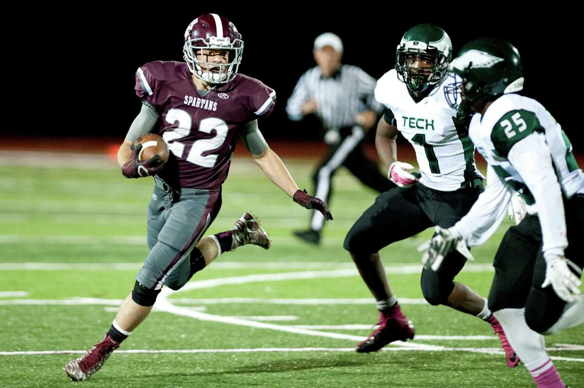 Burnt Hills' Michael Leveroni, left, carries the ball as Green Tech's Ahzir Turner, center, and Damair Skervin defend during their football game on Friday, Oct. 2, 2015, at Burnt Hill High in Burnt Hills, N.Y. (Cindy Schultz / Times Union)